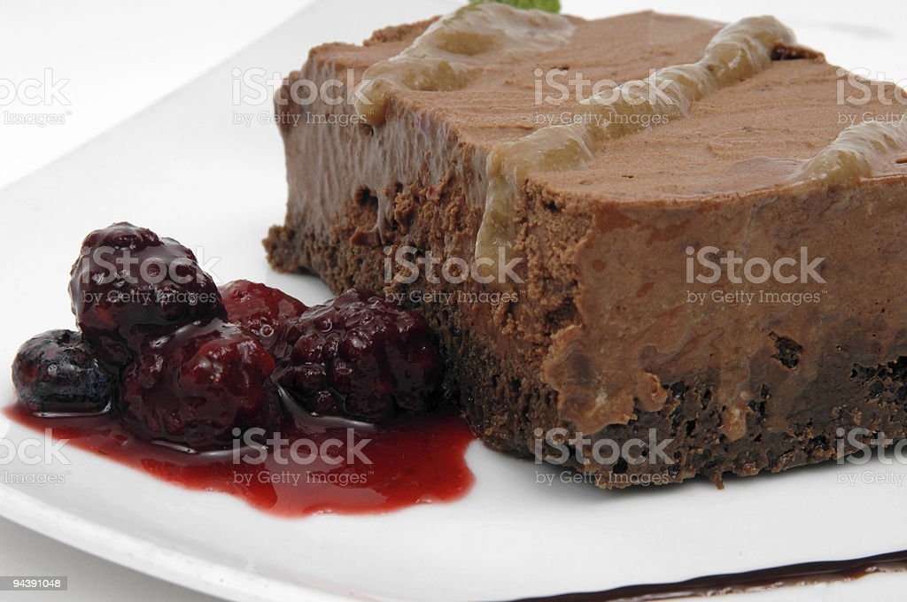 Chocolate cake topped with caramel sauce stock photo