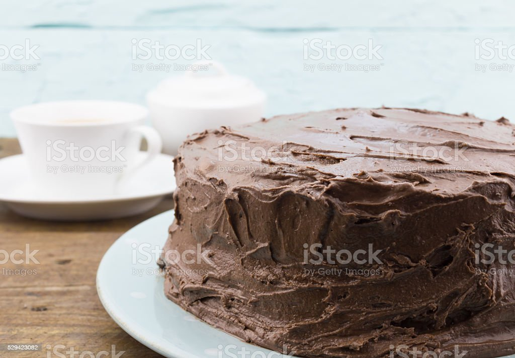 Chocolate cake whole close up on blue plate stock photo