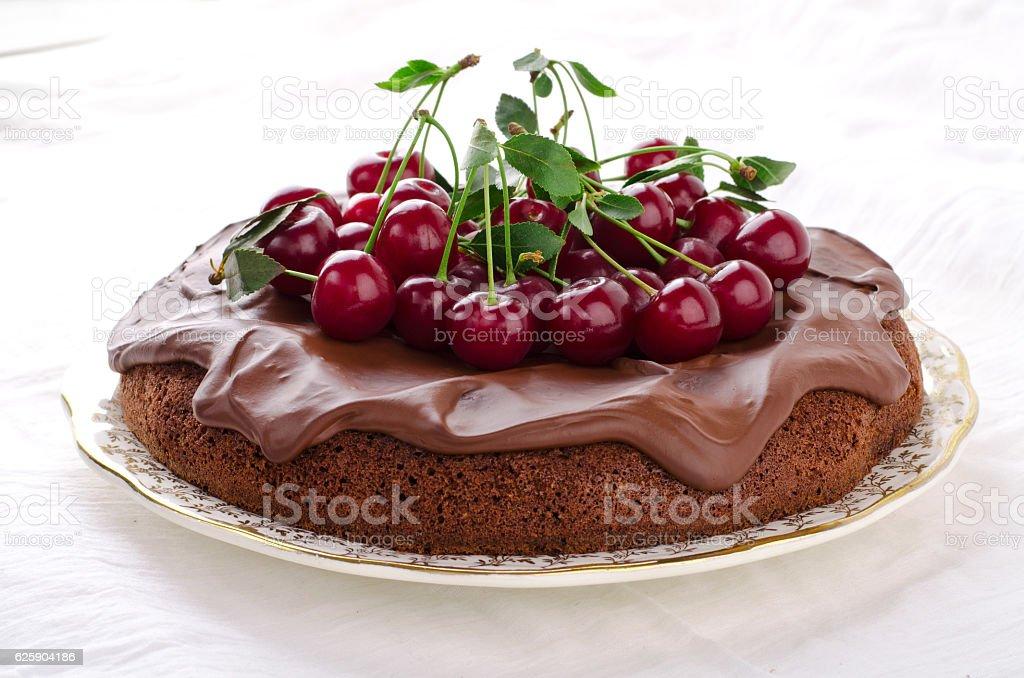 Chocolate cake with cherries and ganache cream. stock photo