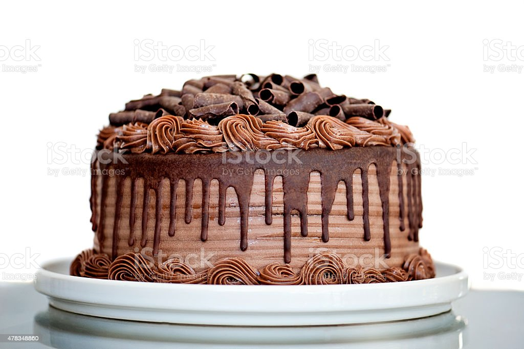 Chocolate Cake with Chocolate Fudge Drizzled Icing and Chocolate Curls stock photo