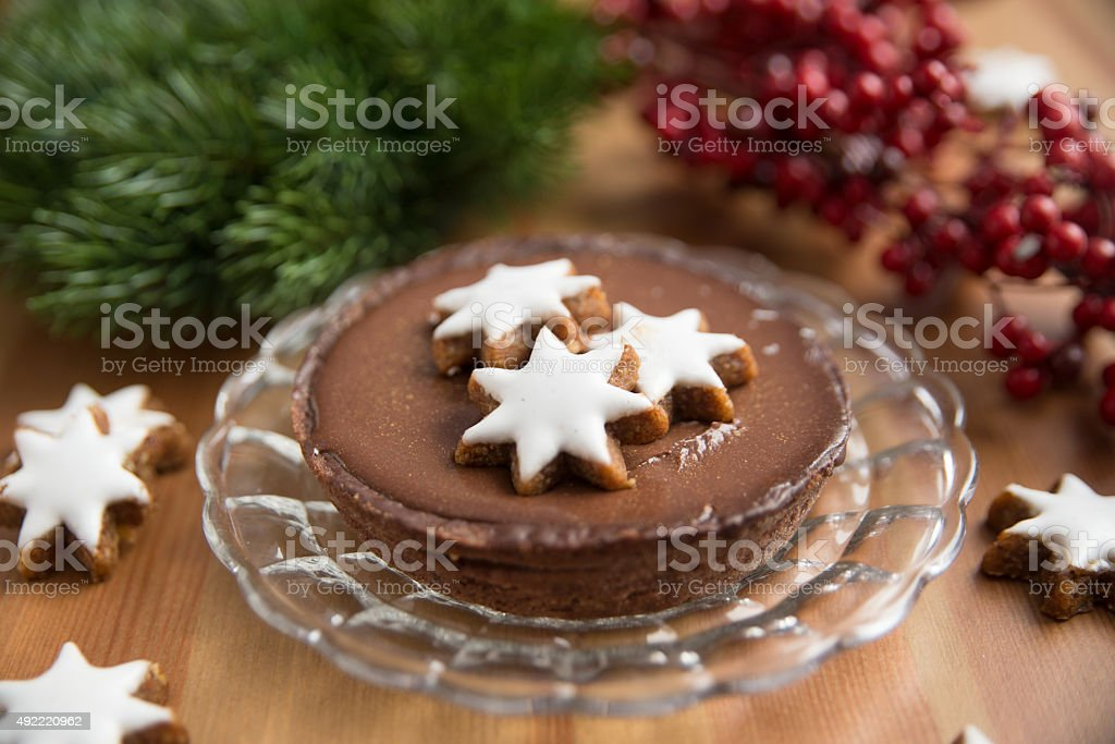 Chocolate Cake with cinnamon star cookies stock photo