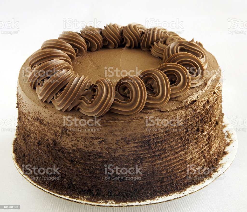 A chocolate cake with frosted icing royalty-free stock photo