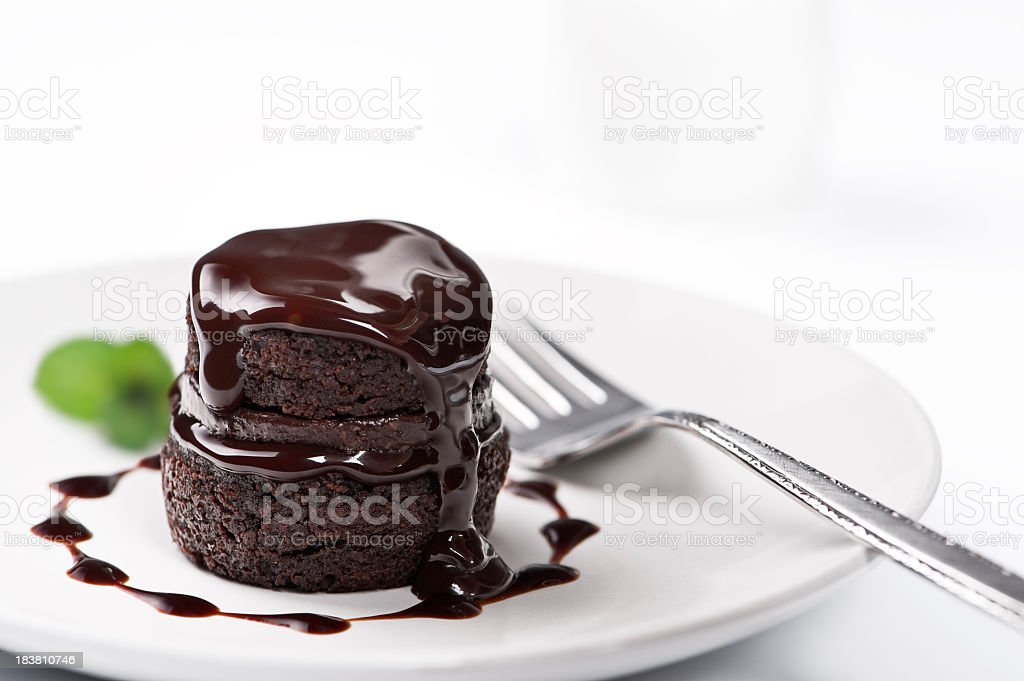 Chocolate cake with melted chocolate on top stock photo
