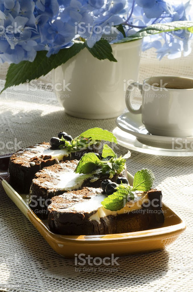 Chocolate cake with mint, blueberries and cap of coffe royalty-free stock photo