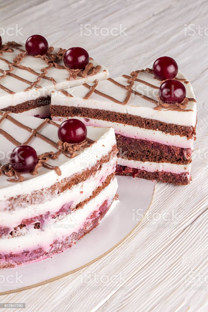 Chocolate cake with mousse, decorated cherries stock photo