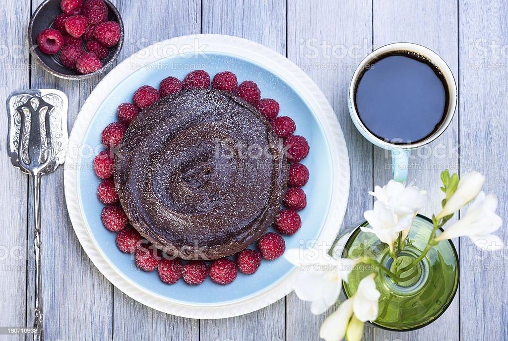 chocolate cake with raspberries and flowers royalty-free stock photo