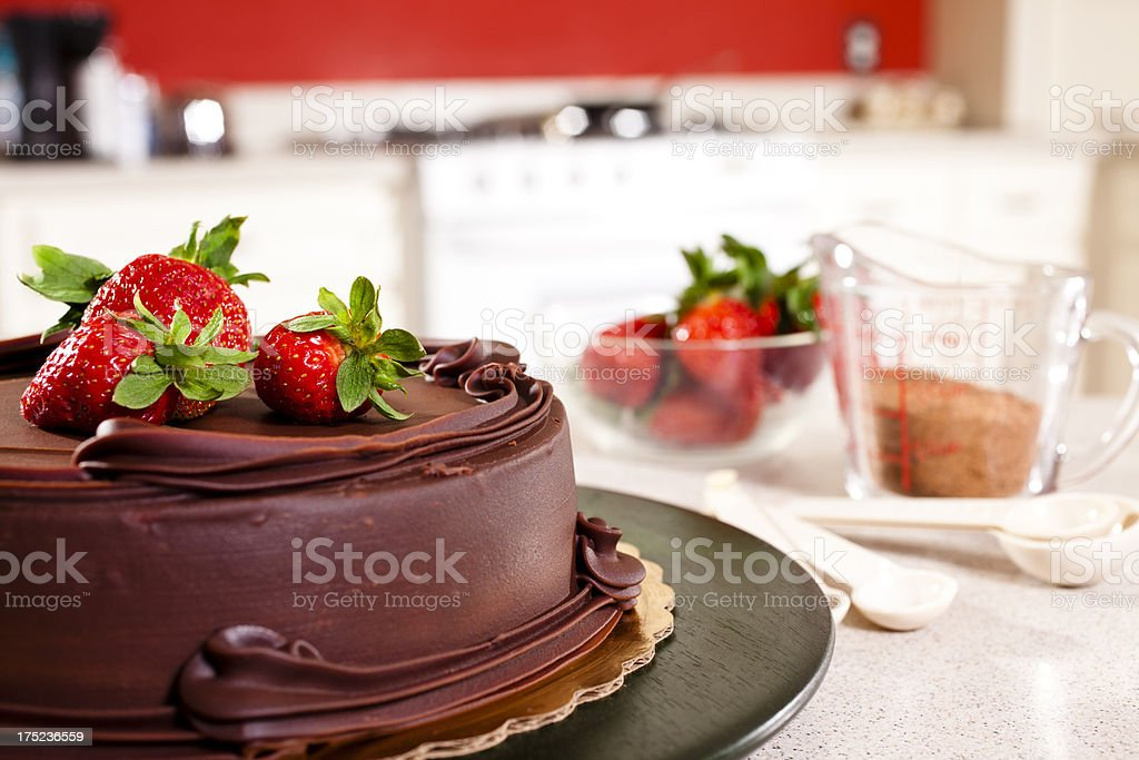 Chocolate Cake with Strawberries in domestic kitchen. royalty-free stock photo