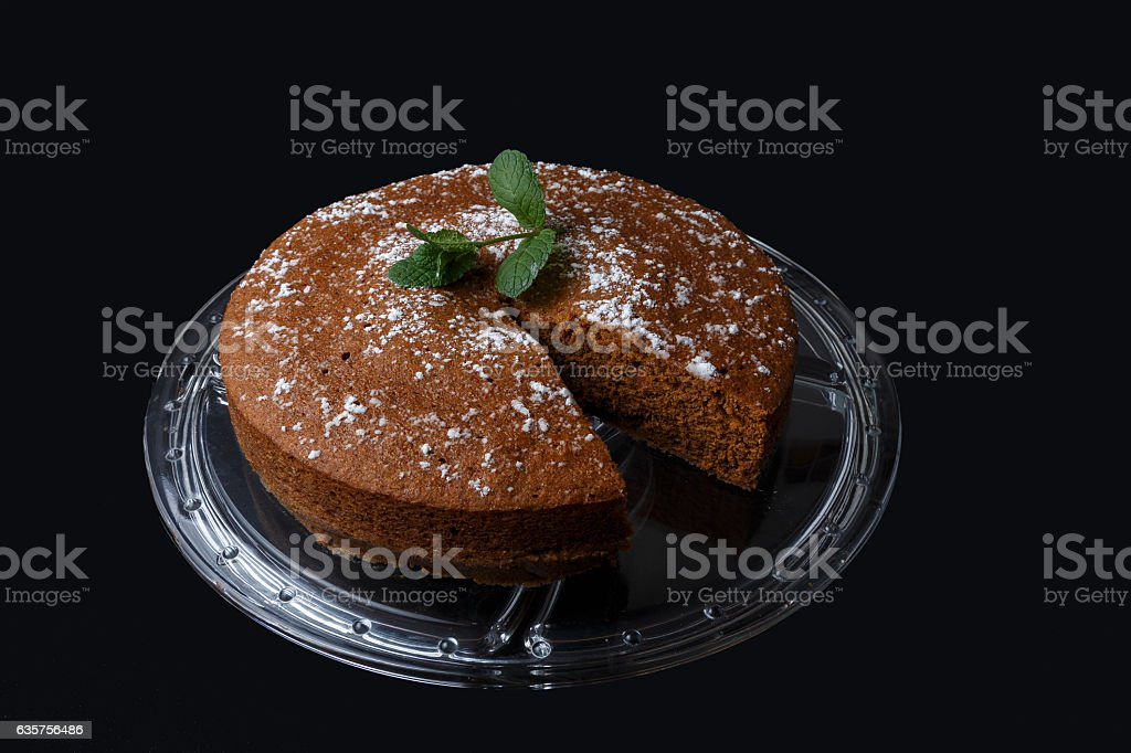 Chocolate cake with sugar decoration on glass stand stock photo