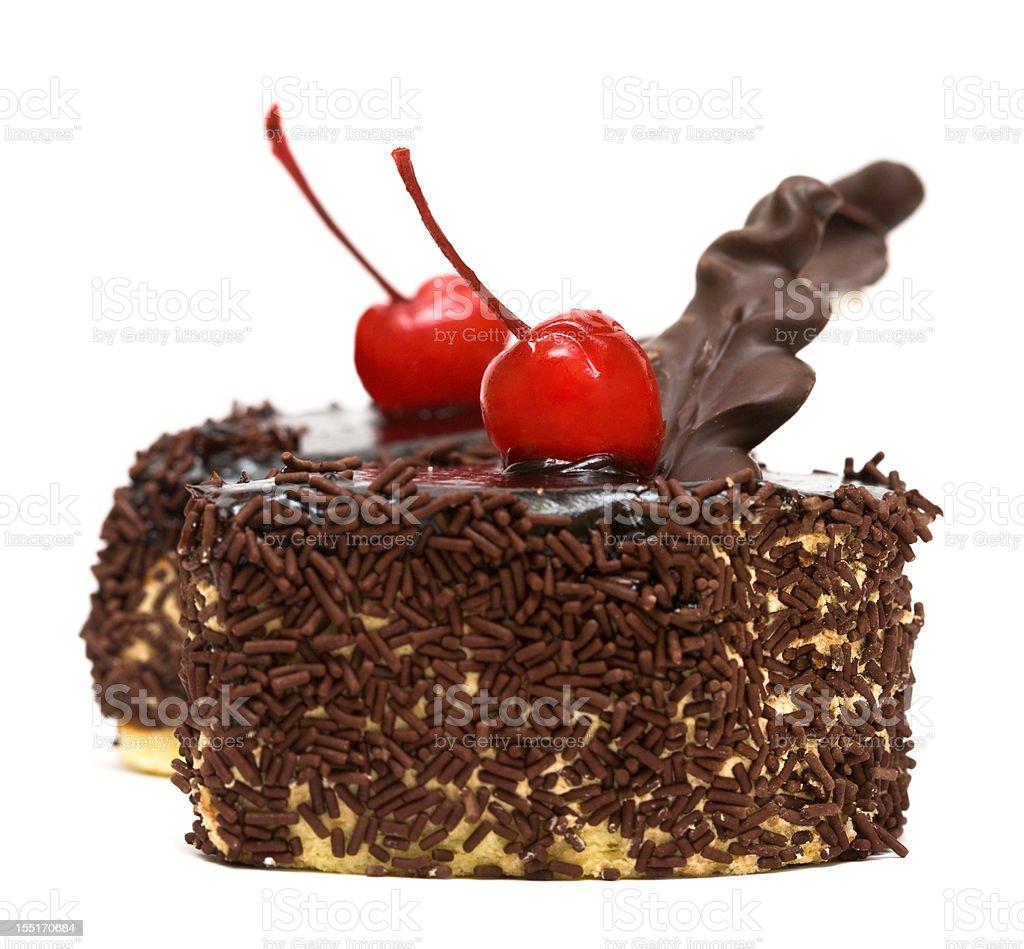 Bolo de chocolate com Cereja vermelha foto de stock royalty-free