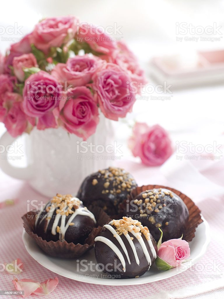 Chocolate cakes with white chocolate and sprinkles stock photo