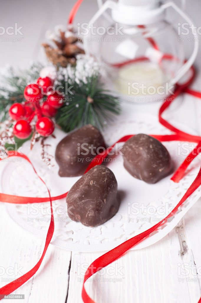 Chocolate candies and Christmas accessories stock photo