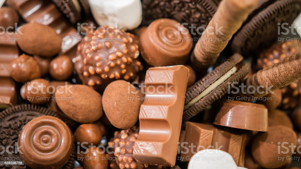 Chocolate, candies, and cookies on table stock photo
