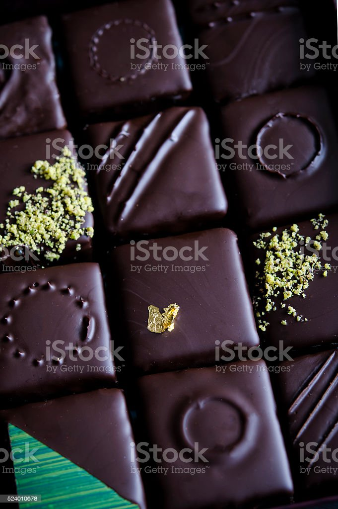 Chocolate candy with pistachio marzipan stock photo
