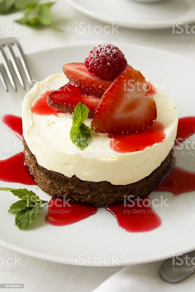 Chocolate cheescake with strawberries stock photo