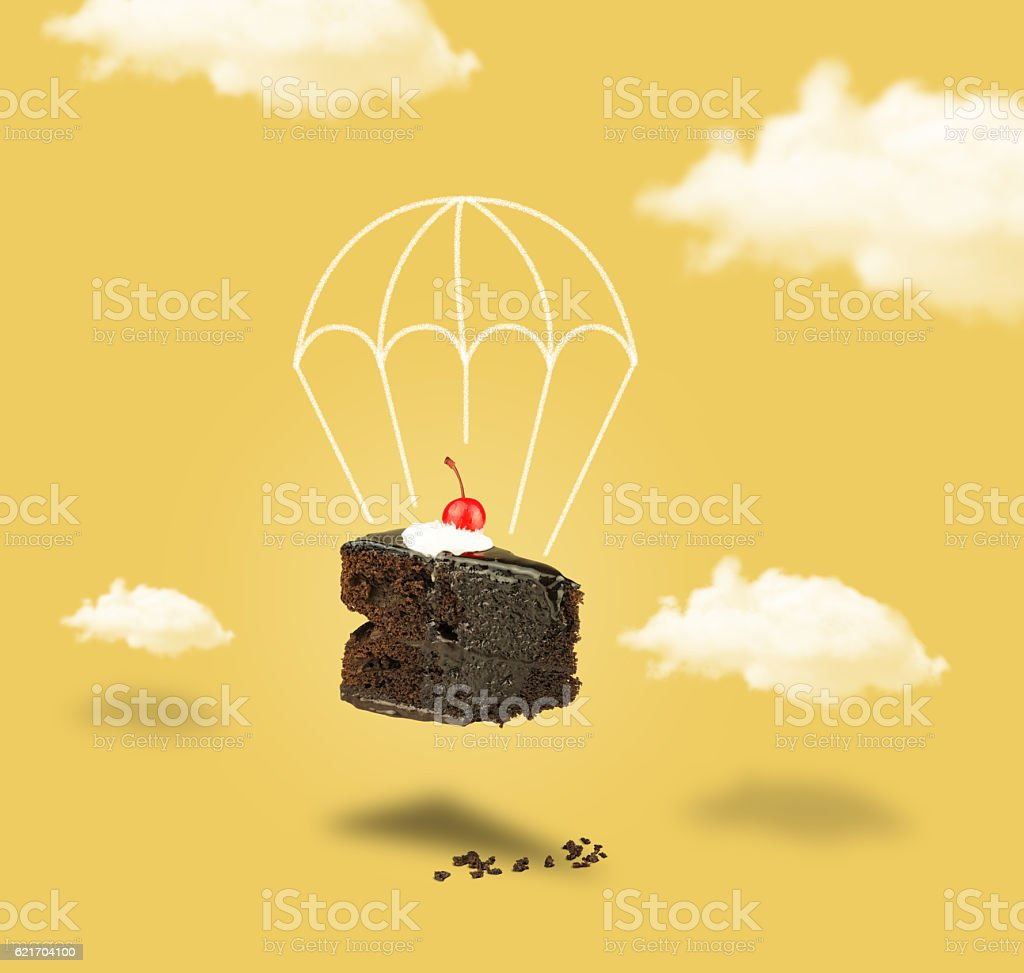 Chocolate cherry cake with parachute on yellow sky without text stock photo