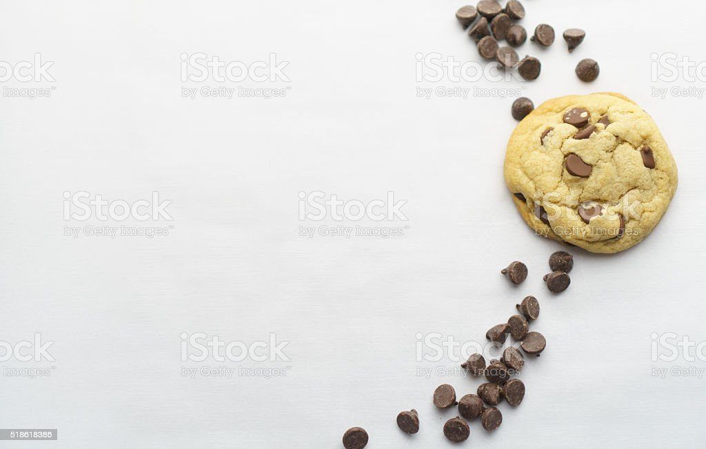 Chocolate Chip Cookie, Chocolate Chips and White Space stock photo