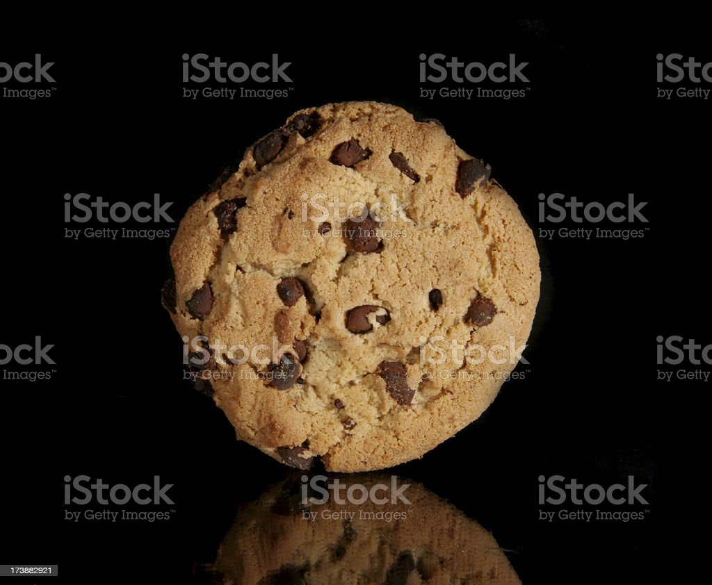 Chocolate Chip Cookie Isolated on Black with Reflection royalty-free stock photo