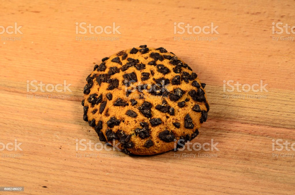 Chocolate chip cookie on a wooden table stock photo