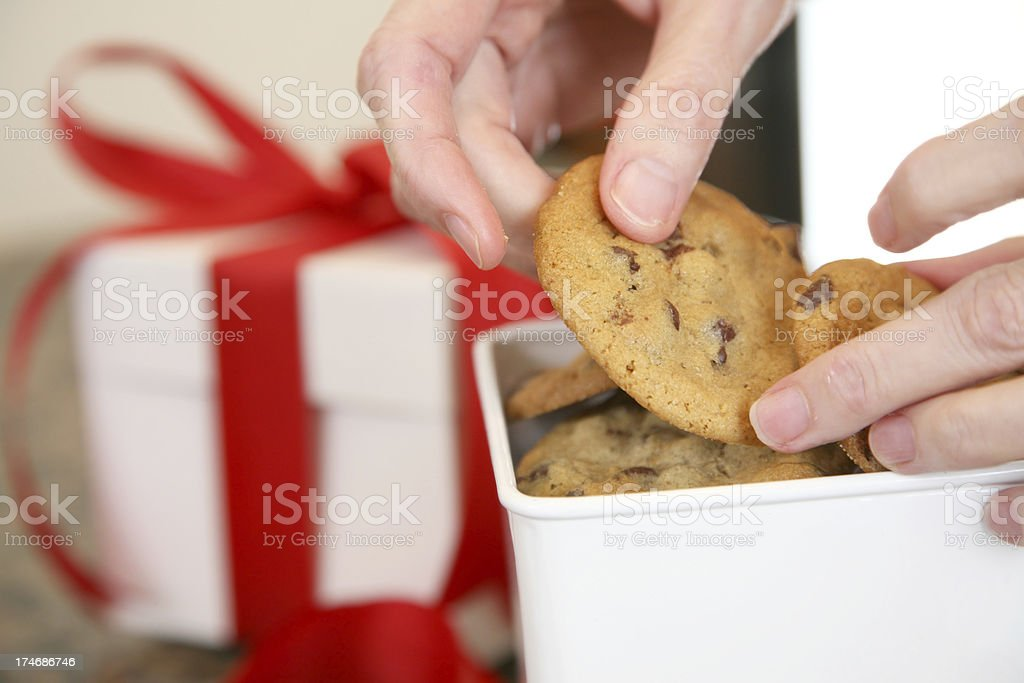Chocolate Chip Cookies Being Placed in Box as a Gift royalty-free stock photo