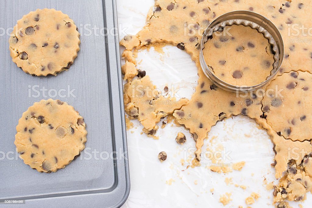 Chocolate chip cookies on a baking tray stock photo
