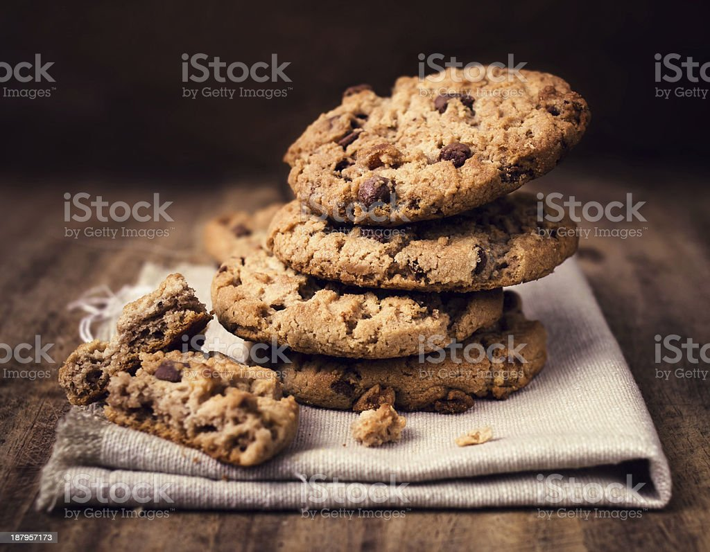 Chocolate chip cookies on linen napkin wooden table. stock photo