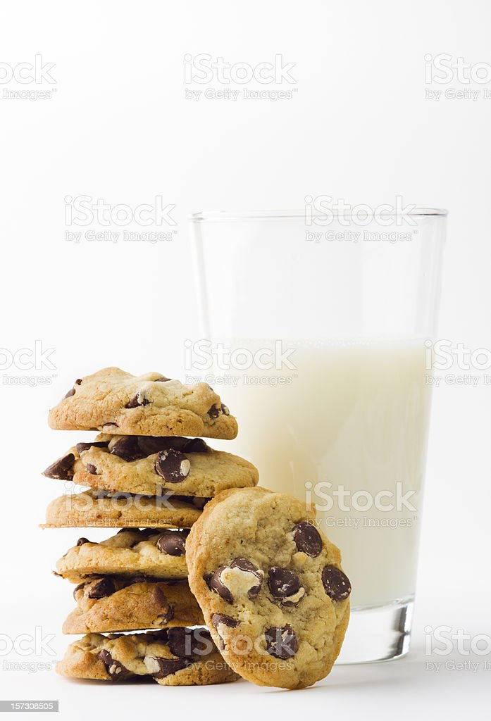 Chocolate Chip Cookies with Glass of Milk on White Background stock photo