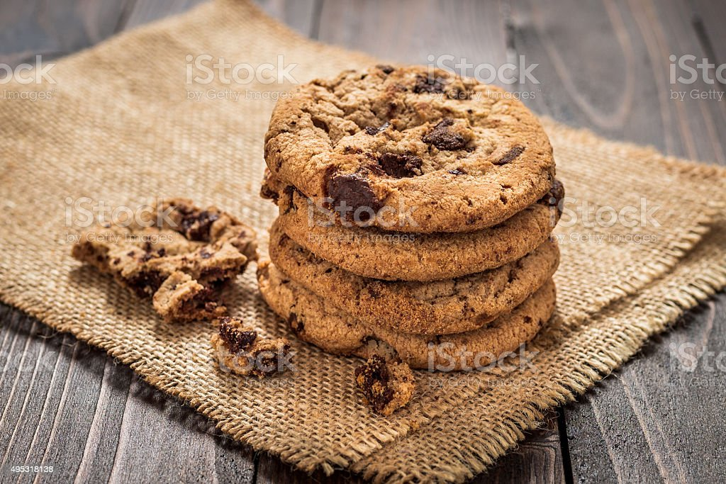 Chocolate chip cookies with wooden background stock photo