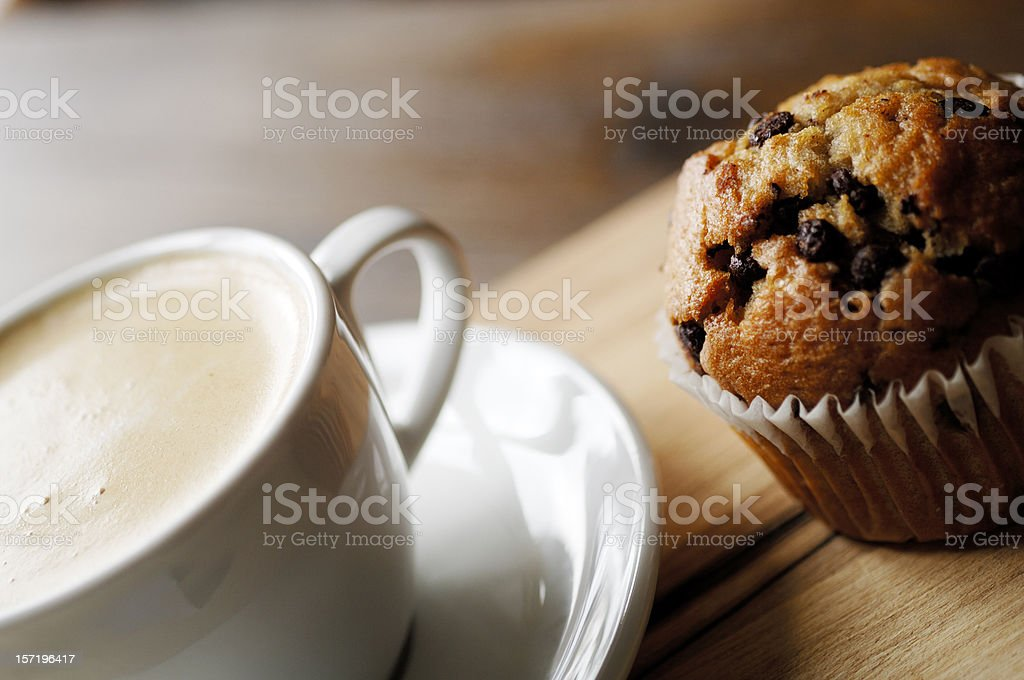 chocolate chip muffin and cup of coffee stock photo