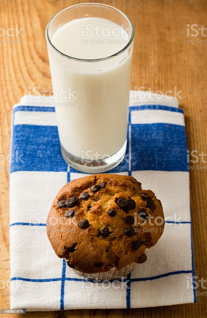 chocolate chip muffin on cloth stock photo