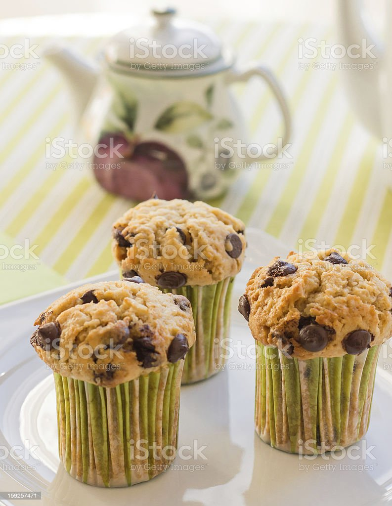 Chocolate chip muffins on white plate and green striped tableclo royalty-free stock photo