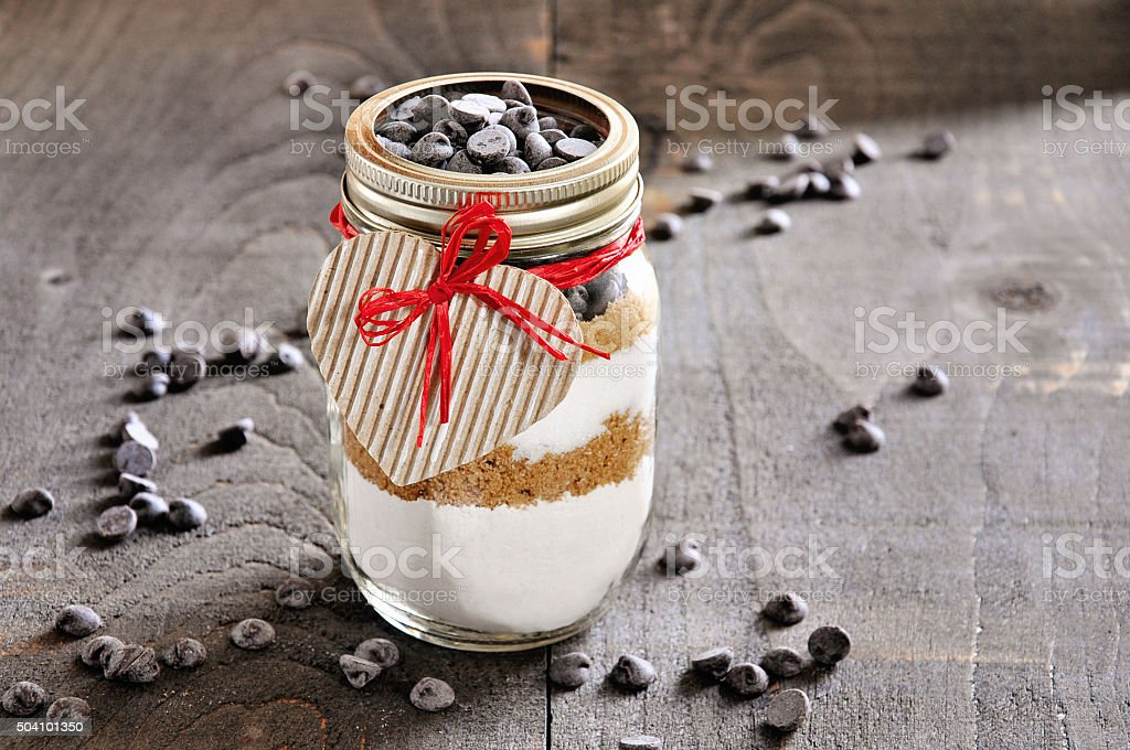 Chocolate chips cookie mix in a glass jar. stock photo