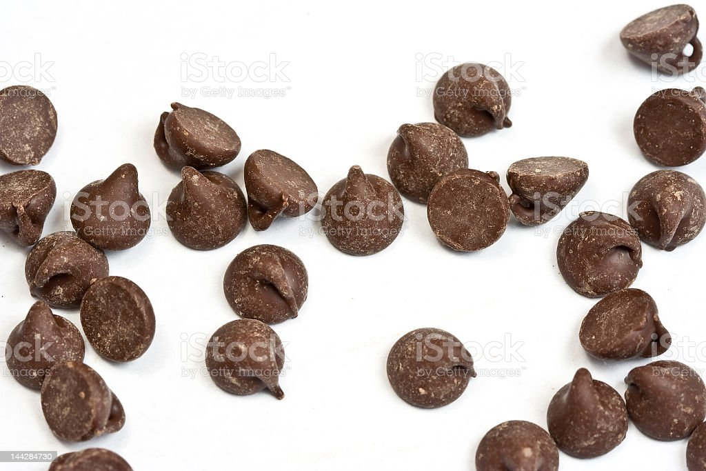 Chocolate chips on a white background stock photo