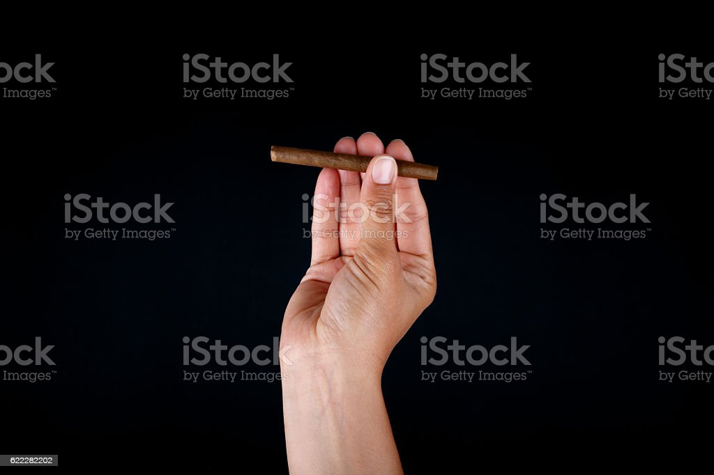 Chocolate Cigar in Hand stock photo