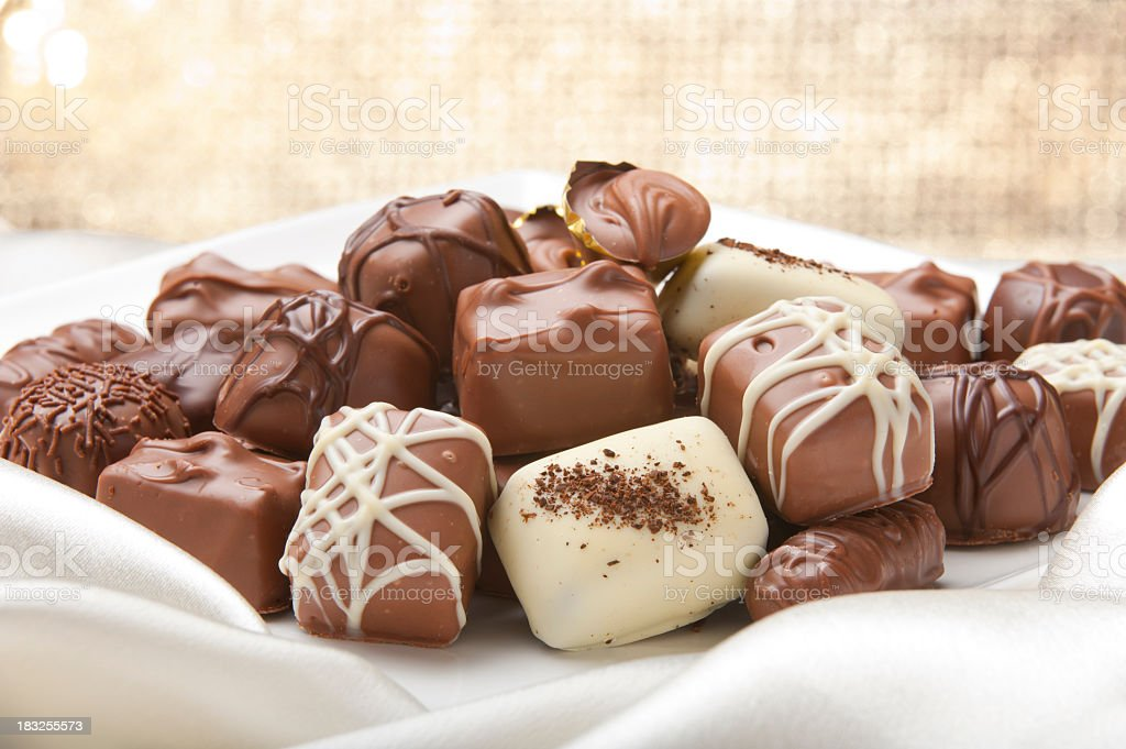 Chocolate collection on a silk ackground stock photo