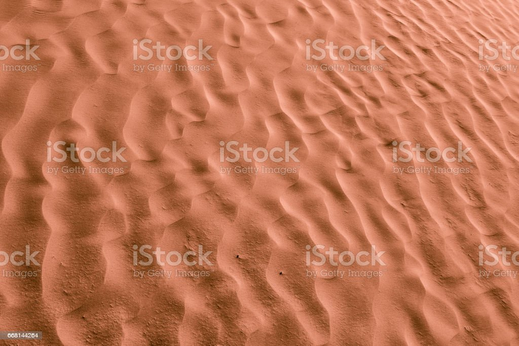 Chocolate color sands of the desert. Background and Texture stock photo