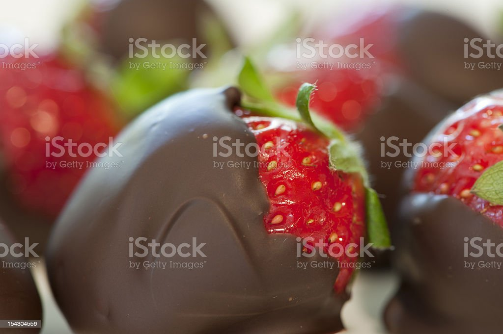 Chocolate colored strawberries stock photo