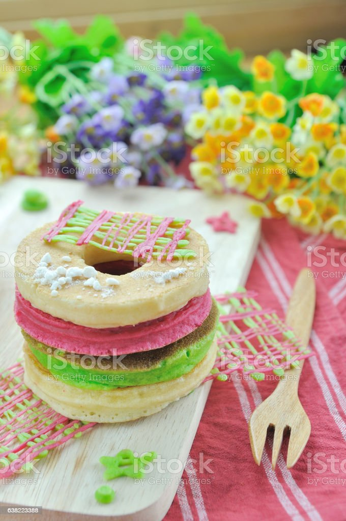 Chocolate cookie and Stack of color pancake with honey stock photo