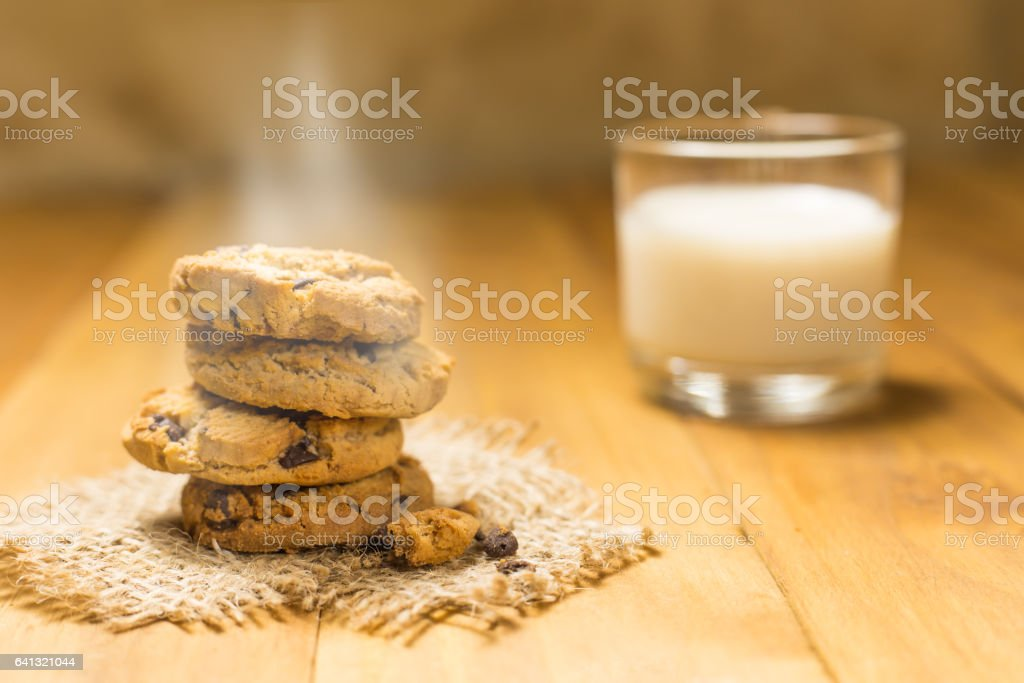 Chocolate cookies on a cloth sack on wood. stock photo