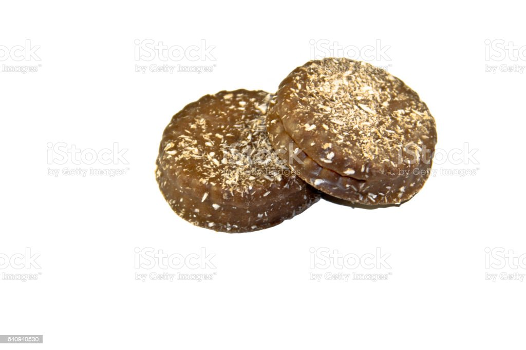 Chocolate cookies with coconut shaving isolated on the white background stock photo