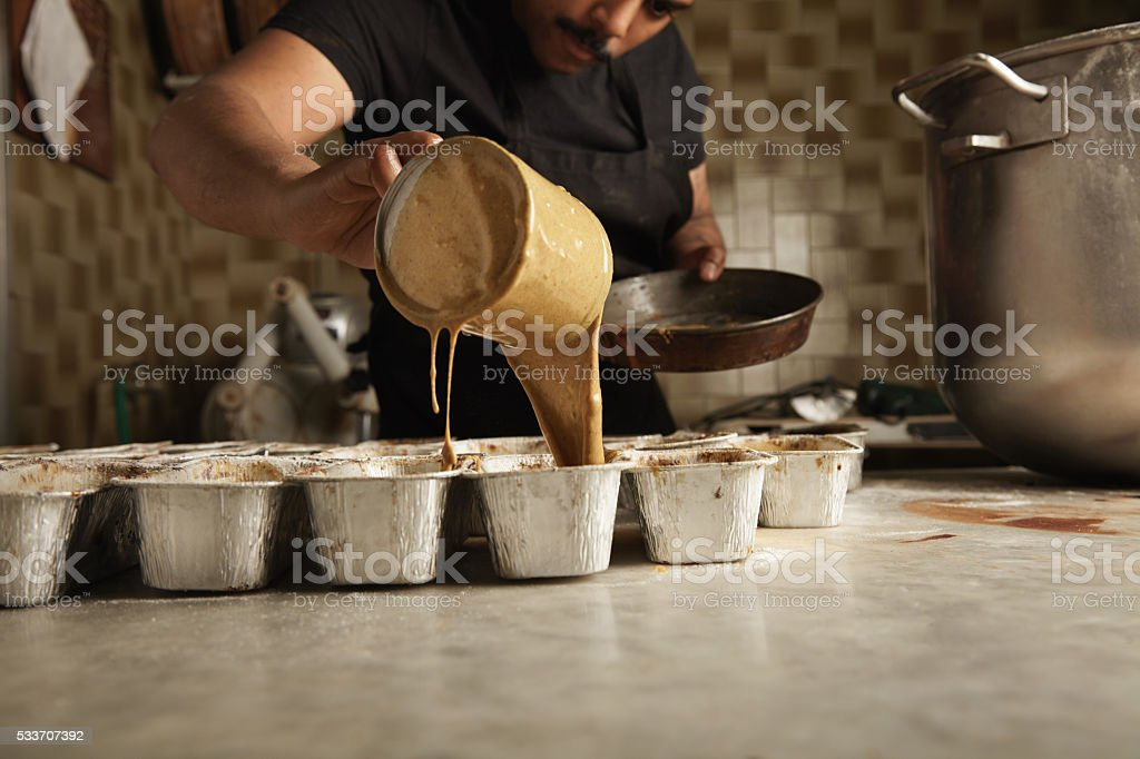 Chocolate cooking in professional artisan confectionery stock photo