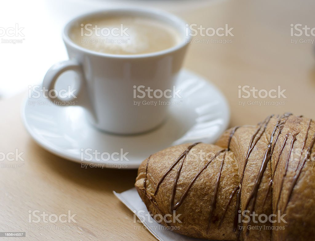 Chocolate cornetto with cappuccino royalty-free stock photo