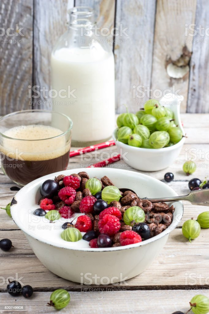 Chocolate cornflakes with berries stock photo
