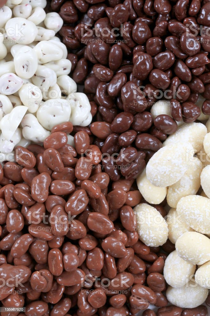 Chocolate covered nuts and fruit stock photo