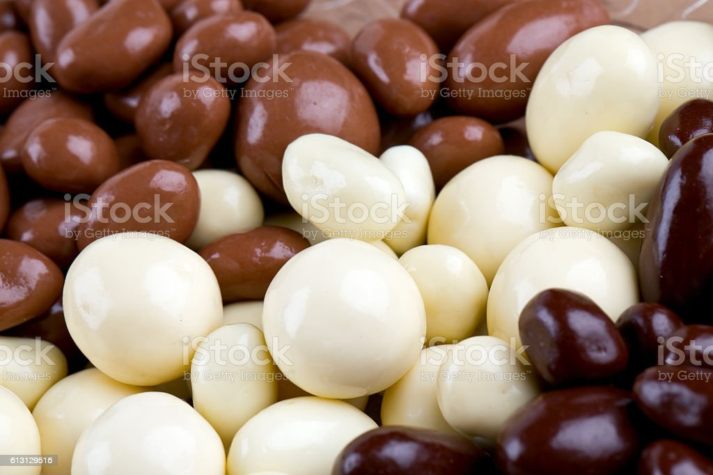 chocolate covered nuts and raisins background stock photo