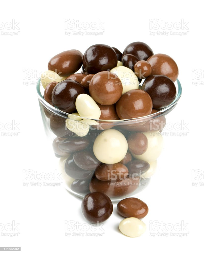 chocolate covered nuts and raisins isolated on white stock photo
