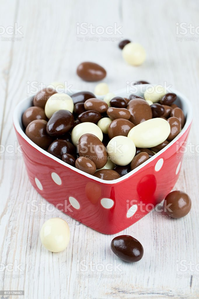 chocolate covered nuts and raisins stock photo