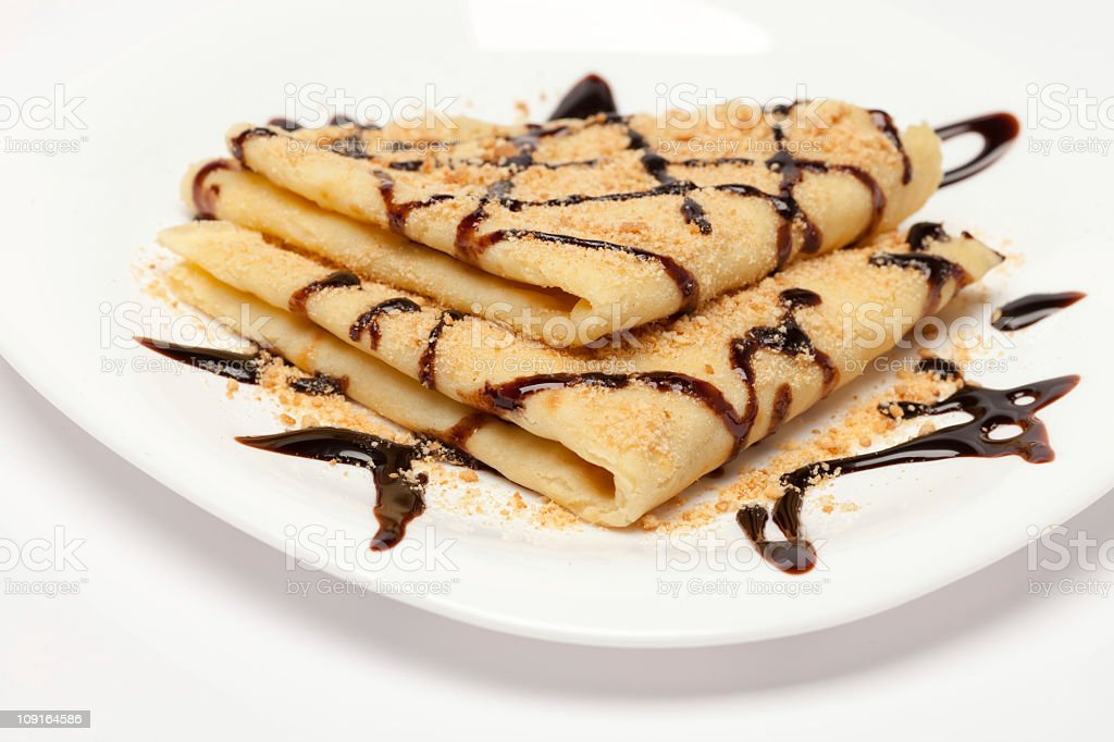 Chocolate crepes (pancakes) served on white plate stock photo