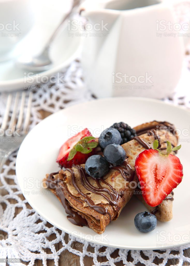 Chocolate crepes with fresh berries royalty-free stock photo