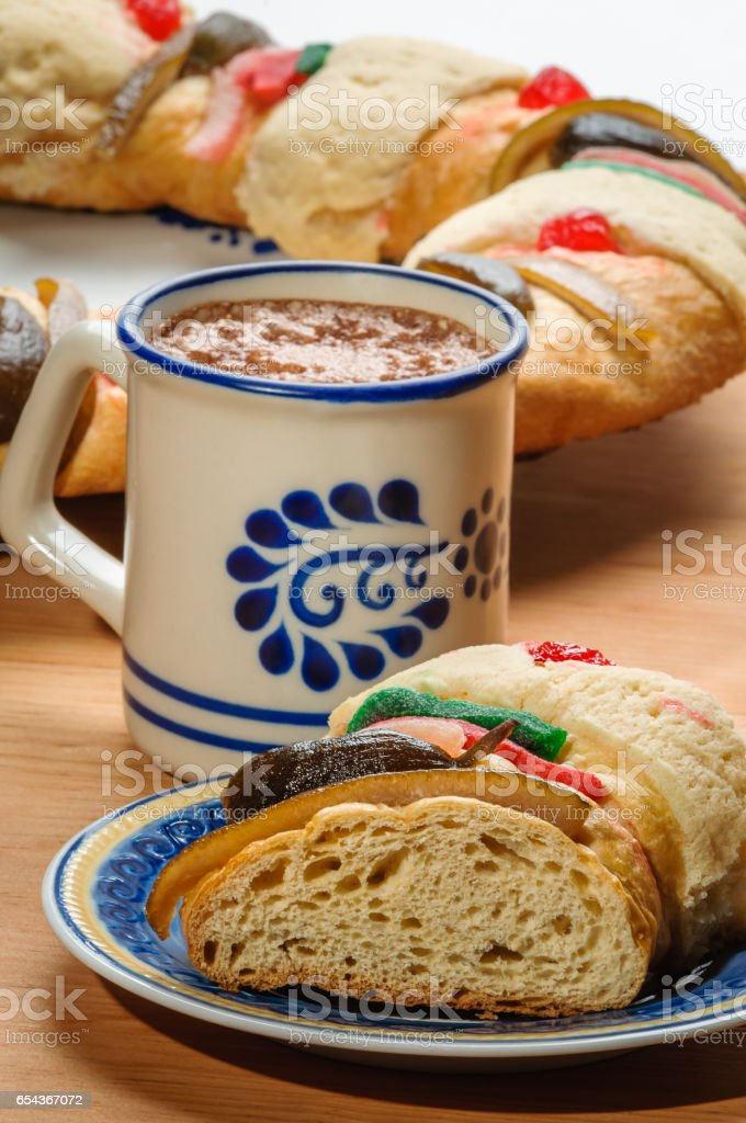 Chocolate cup with Rosca de reyes, Epiphany cake, Kings cake, Roscon de reyes stock photo