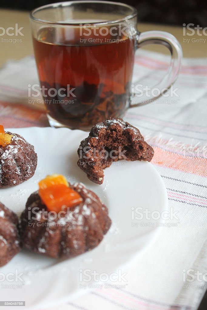 Chocolate cupcakes with mint on wooden table stock photo